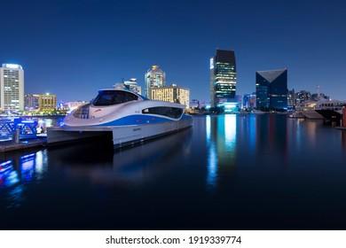 Dubai, UAE, 23 November 2020:  Modern ferry of Dubai RTA docked at Dubai Creek or Al Seef area. Public water transportation connecting several districts like Business Bay and Marina.