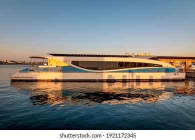 Dubai, UAE, 23 November 2020: Modern ferry of Dubai RTA docked at Dubai creek. Public water transportation connecting several districts like Business Bay and Marina.