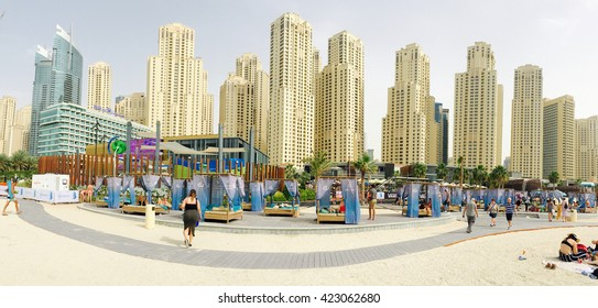 Dubai, UAE - 28th March 2016: Panoramic view of beach and tourists sunbathing on holiday in JBR in Dubai, UAE