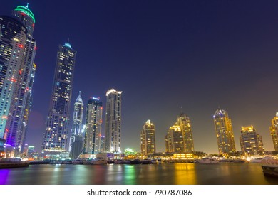 DUBAI, UAE - 30 MARCH 2014: Skyscrapers of Dubai Marina at night, UAE. Dubai Marina is a district in Dubai with artificial canal city who accommodates more than 120,000 people at Persian Gulf.