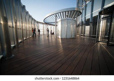 Dubai, UAE - 4 May 2013: Tourists enjoing the highest view point in the world at the top of Burj Khalifa building