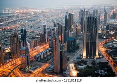 Dubai, UAE - 4 May 2013: The Dubai downtown during sunrise viewed from Burj Khalifa view point