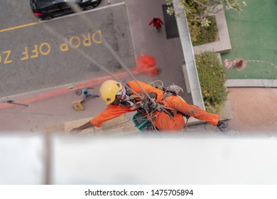 Dubai, UAE / UAE - 6 Aug 2019: Window cleaner on the job and doing our Flats at JLT Dubai.