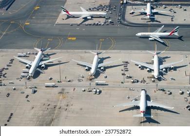 DUBAI, UAE - APR 7:  Planes at Dubai Airport on Apr 7, 2014 in Dubai, UAE. Dubai International Airport is the largest airport in United Arab Emirates