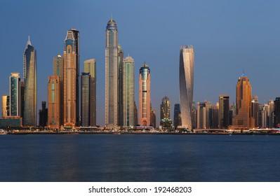 DUBAI, UAE - APR 9: Dubai, UAE. A section of Dubai Marina at dusk as viewed from Palm Jumeirah on Apr 9, 2014 in Dubai, UAE. This part of Dubai has more skyscrapers over 50 stories that Manhattan