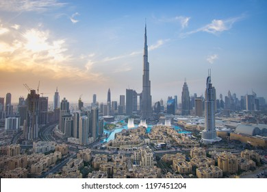 Dubai, UAE - April 07, 2018: Burj Khalifa and Dubai Fountain against the sunset