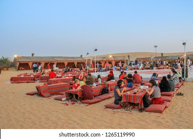 DUBAI, UAE – April 1 2013: Tourists and visitors arrive at the traditional Bedouin camp to have diner and enjoy folk show after experiencing desert safari