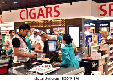 Dubai, UAE - April 10. 2018. The buyer at checkout in duty free shop at the airport