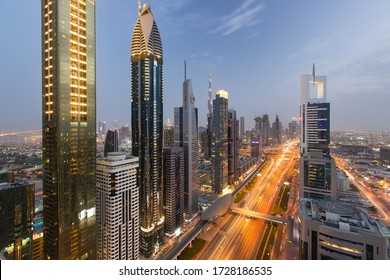 Dubai, UAE - April 13, 2018 - View of Dubai Skyline and Sheikh Rayed Road at the golden hour.