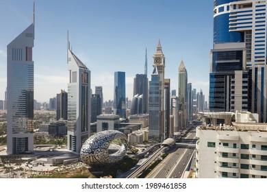 Dubai, UAE – April 16, 2021: Sheikh Zayed Road, top view on  Museum Of The Future, Jumeirah Emirates Towers Hotel, Gevora Hotel, DIFC, Al-Yaqub Tower, Burj Khalifa, HHHR Tower