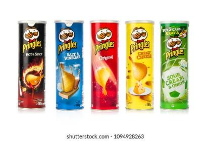 Dubai, UAE – April 19 : Pringles tubes five flavors isolated on white background on 19/04/2016 in Dubai