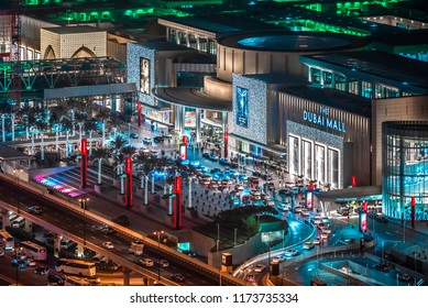 DUBAI, UAE - APRIL, 2018: High rooftop exterior view of The Dubai mall, the largest mall in the world. Shopping tourist destination attraction. Night scene. Luxury travel concept.