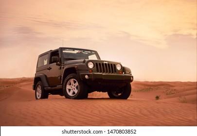 Dubai, UAE - APRIL 23, 2017: Jeep wrangler offroad adventure in the red desert of dubai on the sand dune