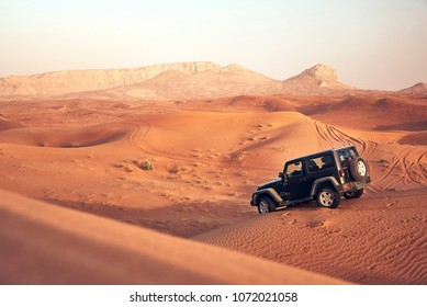 Dubai, UAE - APRIL 24, 2017: Jeep wrangler offroad adventure in the red desert of dubai on the sand dune