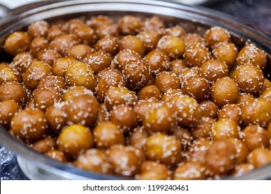 DUBAI, UAE - APRIL 5, 2014: A traditional Emirati dish called luqaimat (fried dough balls). The doughnuts are often drizzled with date syrup and eaten at Ramadan.