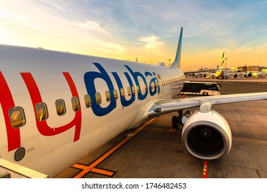 DUBAI, UAE - APRIL 5, 2020: Airplane Flydubai Boeing 737-800 at Dubai International Airport at sunset, Dubai, United Arab Emirates