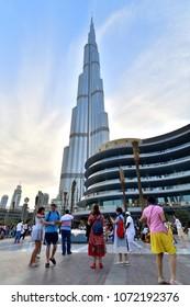 Dubai, UAE - April 8. 2018. Tourists in square in front of Burj Khalifa and Dubai Mall