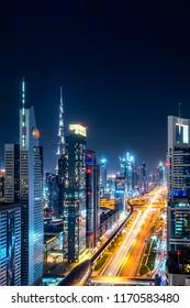 DUBAI, UAE - AUGUST, 2017: Futuristic cityscape scene of Dubai with Sheikh zayed road and Burj Khalifa. Tallest tower.