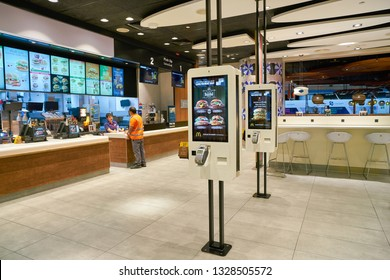 DUBAI, UAE - CIRCA JANUARY, 2019: self-ordering kiosks at McDonald's restaurant in Dubai International Airport.