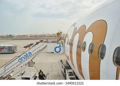 DUBAI, UAE - CIRCA JUNE, 2015: Boeing 777 operated by Emirates Airlines at Dubai International Airport.