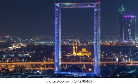 DUBAI, UAE - CIRCA MARCH 2019: Dubai Frame with Zabeel Masjid mosque illuminated at night timelapse. Aerial view from above. The Frame is an architectural landmark in Zabeel Park.