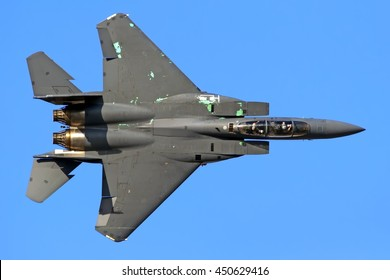 DUBAI, UAE - CIRCA NOVEMBER, 2009: McDonnell Douglas Boeing F-15 Eagle military fighter bomber jet aircraft in classic weathered color scheme flying up side down aerial top down detail exterior view