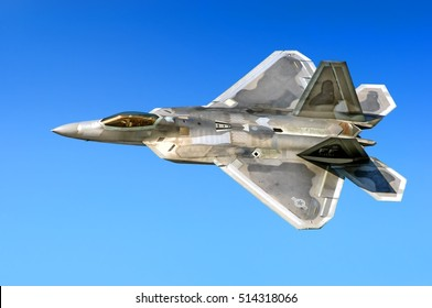 DUBAI, UAE - CIRCA NOVEMBER, 2009: U.S. air force twin jet engine Lockheed Martin F 22 Raptor 5th generation military stealth fighter bomber warbird plane aircraft flying aerial view