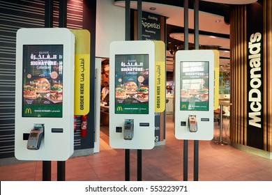 DUBAI, UAE - CIRCA NOVEMBER, 2016: Mcdonald's ordering kiosks at Dubai International Airport. McDonald's is an American hamburger and fast food restaurant chain.