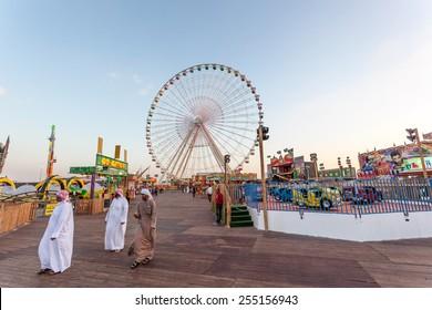DUBAI, UAE - DEC 18: Ferris Wheel at the Global Village in Dubai. December 18, 2014 in Dubai, United Arab Emirates