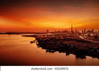 DUBAI, UAE - DEC 22: A beautiful skyline view of Dubai showing the Burj Khalifa on Dec 22, 2015 in Dubai, UAE. Burj Khalifa, the tallest skyscraper in the world, 829.8 m, construction began in 2004
