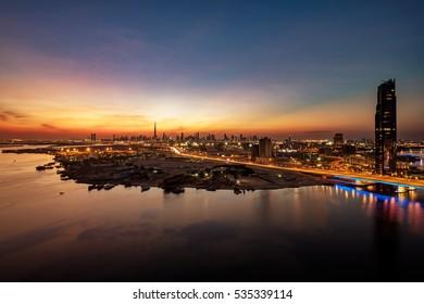 DUBAI, UAE - DEC 22: A beautiful skyline view of Dubai as viewed from Dubai Festival City showing The Creek, Cusiness Bay Crossing and Garhoud Bridges on Dec 22, 2015 in Dubai, UAE