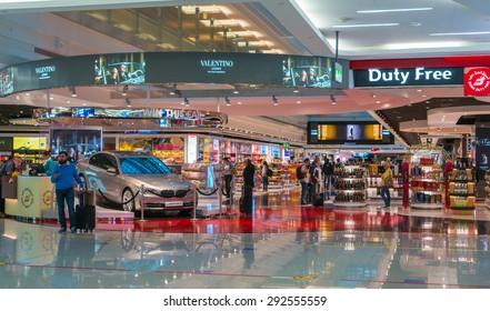 DUBAI, UAE - DEC 31: Glorious duty free shopping area in Dubai International Airport on Dec 31, 2014. Dubai International is the world's busiest airport in terms of international passenger traffic.
