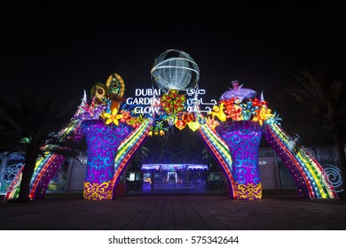 DUBAI, UAE - DEC 6, 2016: Entrance gate to the Dubai Garden Glow family theme park illuminated at night. United Arab Emirates, Middle East