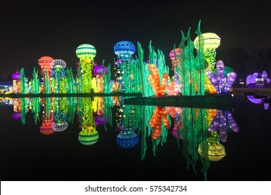 DUBAI, UAE - DEC 6, 2016: Beautiful installations at the Dubai Garden Glow family theme park illuminated at night. United Arab Emirates, Middle East