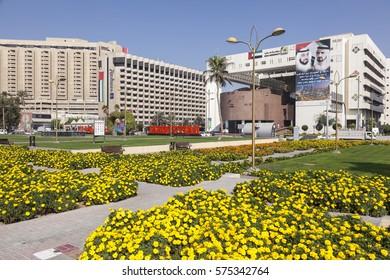 DUBAI, UAE - DEC 6, 2016: Flowers in the city of Dubai. The Dubai Municipality building on the right. United Arab Emirates, Middle East