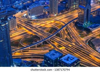 Dubai, UAE - Dec 7, 2018. Aerial view of Dubai City at night. View from rooftop of Burj Khalifa Building.