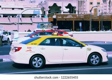 DUBAI, UAE - DECEMBER 10, 2017: Toyota Camry taxi cab in Dubai, UAE. Dubai is the most populous city in UAE and a major global city.