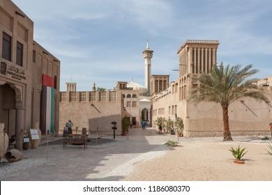 DUBAI, UAE - DECEMBER 16, 2014: Al Fahidi Historical Neighbourhood, also known as Al Bastakiya, in Dubai, United Arab Emirates. The Al Farooq mosque is in the background.