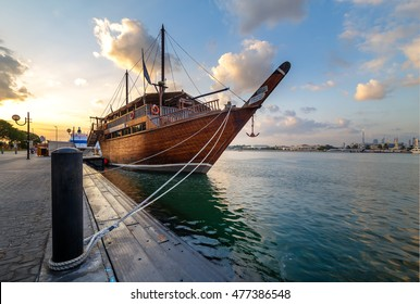 DUBAI, UAE - DECEMBER 2 2014: Traditional wooden dhow cruise across the Creek with a view of skyline of Dubai, United Arab Emirates