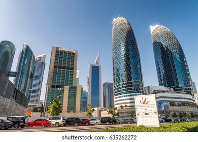 DUBAI, UAE - DECEMBER 2016: Downtown buildings on a beautiful day. Dubai attracts 30 million tourists annually.