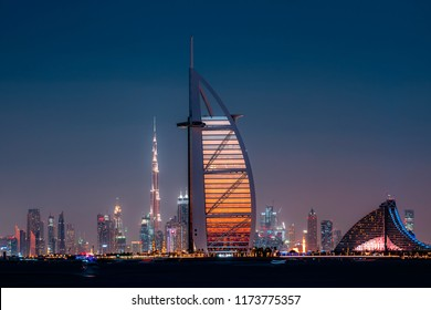 DUBAI, UAE - DECEMBER, 2017: Burj Al Arab and Burj Khalifa and Jumeirah hotel in one frame. Iconic landmarks of Dubai, middle east. Color night view. Luxury travel concept.