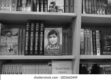 Dubai UAE December 2019 Book of Malala Yousafzai Pakistani activist for female education and the youngest Nobel Prize laureate on the book store. Black and White Photo.