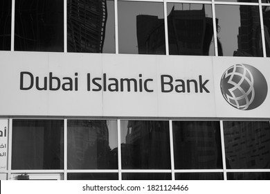 Dubai UAE December 2019 - Dubai Islamic Bank a major Middle Eastern banks building sign logo on large building on a sunny day. Black and White Photo.