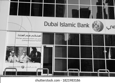 Dubai UAE December 2019 - Dubai Islamic Bank a major Middle Eastern banks building sign logo on large building top on a sunny day. Bank branch store front. Black and White Photo.