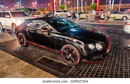 DUBAI, UAE - december 23, 2017: Luxury Supercar Bentley continental gt coupe black color parked next to Dubai mall. Bentley is famous expensive automobile luxury brand car