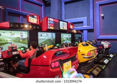 DUBAI - UAE - DECEMBER 26, 2014: Kids play OutRun 2 SP arcade at the Sega Republic indoor Theme Park at The Dubai Mall, Dubai, United Arab Emirates.