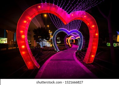 Dubai, UAE - December 3, 2018: Beautiful installations at the Dubai Garden Glow family theme park illuminated at night.