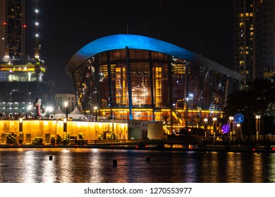 DUBAI, UAE - DECEMBER 30, 2018: Night view of Burj Khalifa Lake, Downtown Dubai and the iconic dhow-shaped building of Dubai Opera is a masterpiece of contemporary design, Burj Park, Downtown Dubai