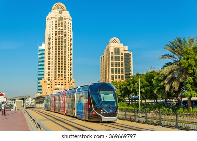 DUBAI, UAE - DECEMBER 31: Alstom Citadis 402 tram on December 31, 2015 in Dubai, UAE. The only line with 11 stations was inaugurated on 11 November 2014