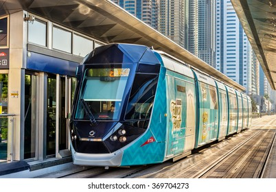 DUBAI, UAE - DECEMBER 31: Alstom Citadis 402 tram on December 31, 2015 in Dubai, UAE. The system is wireless as it uses a ground-level power supply